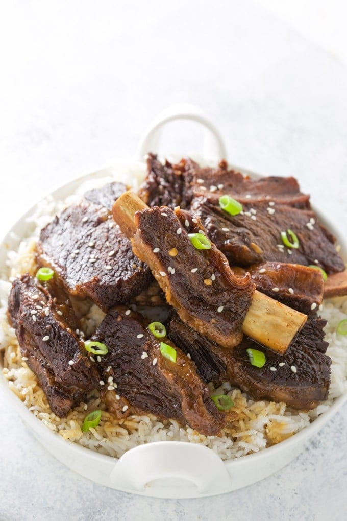 Tasty, tender Pressure Cooker Korean Beef Short Ribs! They are fall apart tender, taste delicious and are easily made in your Instant Pot or other electric pressure cooker. This recipe is gluten free.