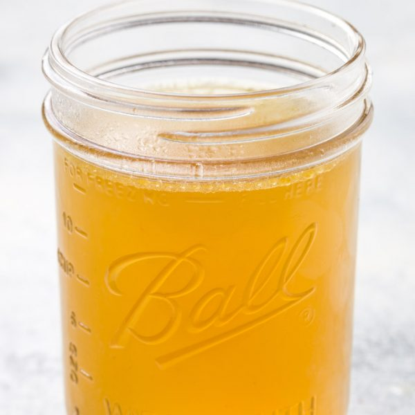 homemade chicken broth in a mason jar
