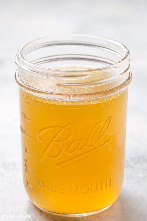 homemade chicken broth in a mason jar
