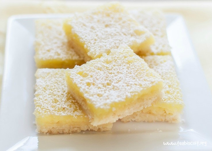 Gluten and Dairy Free Lemon Squares with the best shortbread base ever! | noshtastic.com