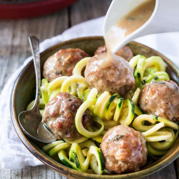 Easy Paleo Whole 30 sage and onion Meatballs with Creamy Dairy Free Gravy made with coconut milk, served with zucchini noodles (zoodles)