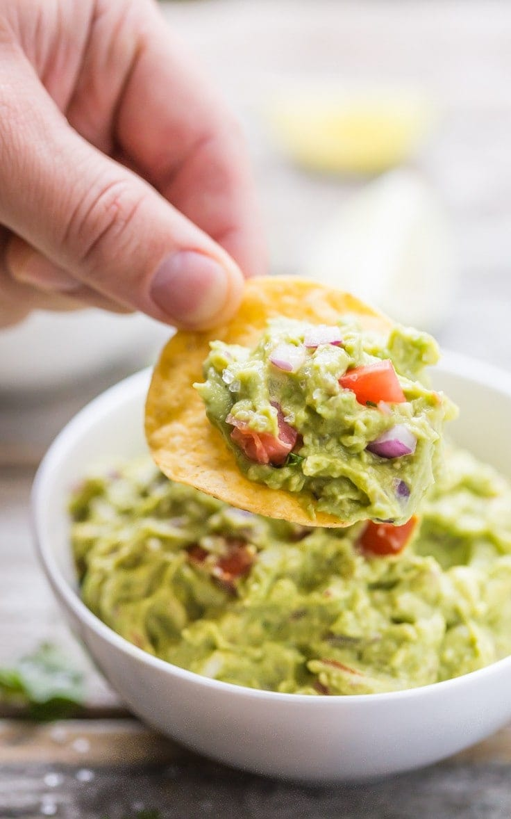Quick and easy Guacamole, SO much tastier store bought! Gluten Free, dairy free, vegan, vegetarian, paleo, primal, and Whole 30 compliant.