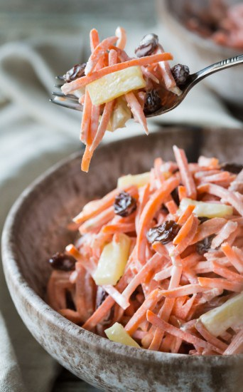 A very easy nutritious Paleo, Whole 30, and Gluten Free Carrot Raisin Pineapple Salad that requires no cooking and can be made in just a few minutes! It's vegetarian and you can make it vegan with a mayonnaise substitute.