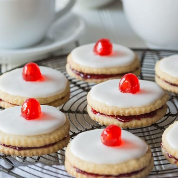 Delectable Scottish Gluten Free Empire Biscuits are tasty little shortbread cookies sandwiched together with jam and iced on the top, perfect with a nice cup of tea!
