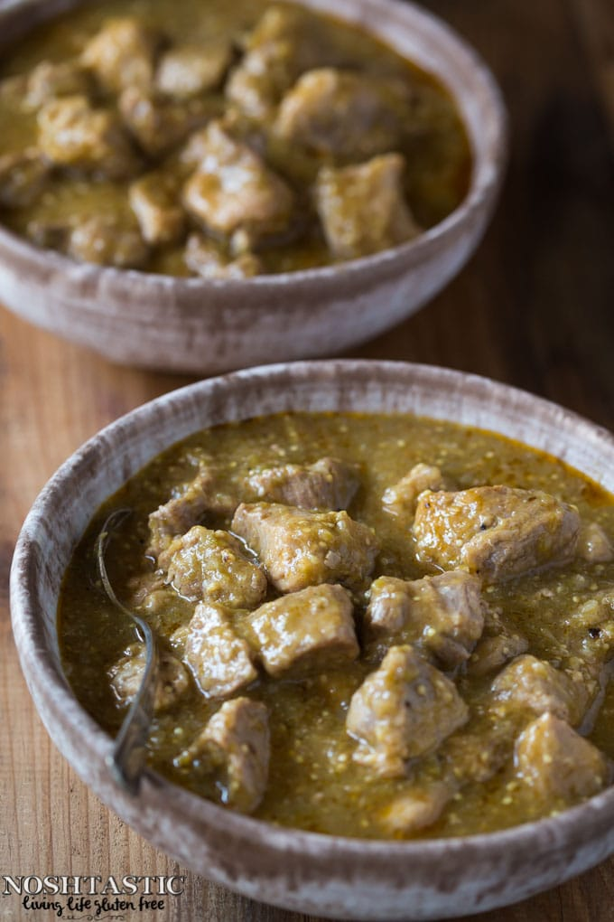 Easy Paleo Chili Verde recipe with roasted tomatillos, garlic, onion, and tender pieces of pork that melt in your mouth! it's Gluten Free and Whole30 too.
