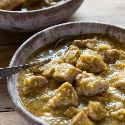 Pressure Cooker Paleo Chile Verde recipe with roasted tomatillos, garlic, onion, and tender pieces of pork that melt in your mouth! it's Gluten Free and Whole30 too.