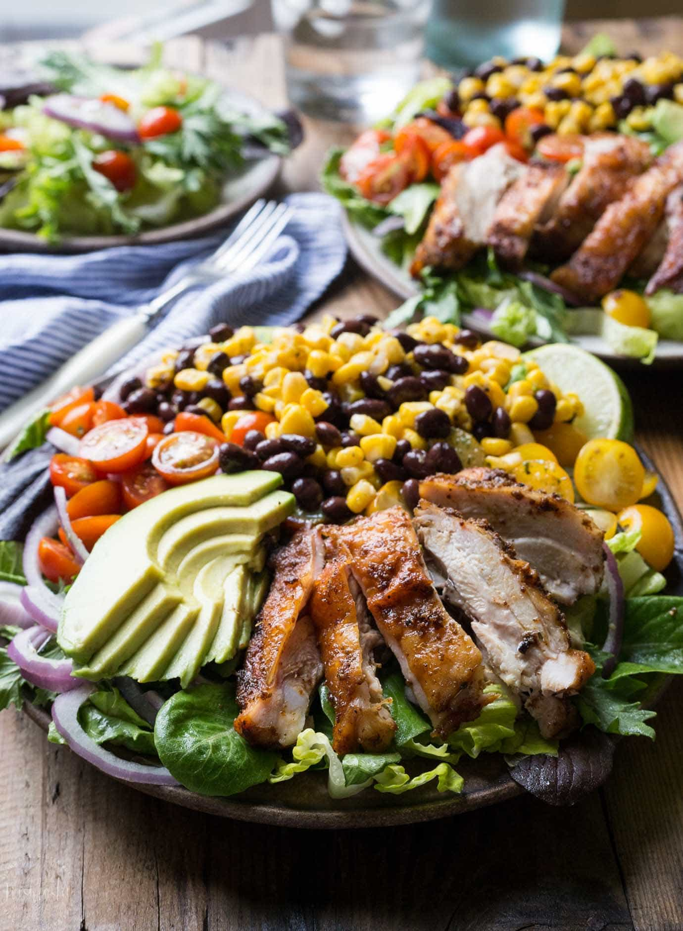 Southwest Chicken Salad with corn, beans, red onion, avocado, with Cilantro Lime Dressing