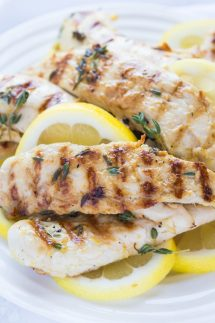 Low carb Grilled Paleo Lemon Chicken with Thyme, delicious and bursting with fresh herbs and garlic! Cook on an indoor cast iron grill pan or outdoor grill.