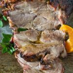 A deliciously tasty Cuban Pork roast that is fall of the bone tender! Marinaded in a combination or warm spices, subtle herbs, lime and orange juice, this pork roast will melt in your mouth! It's Paleo, Whole30 and Gluten Free.