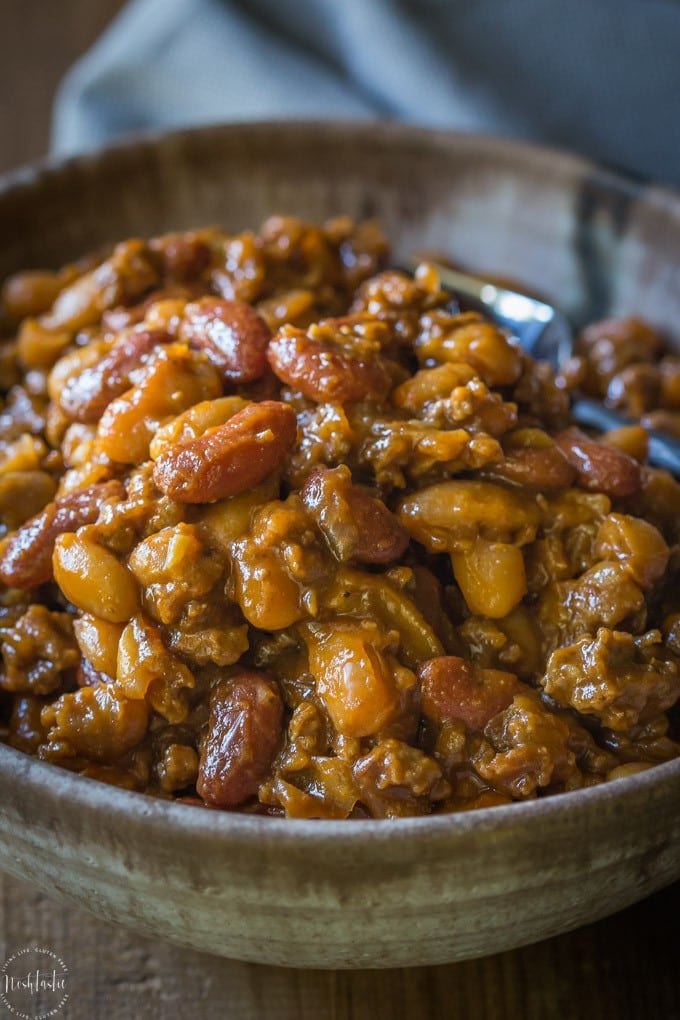 Best BBQ Baked Beans with Beef, this is hands down the most popular recipe I've made all year, so, so tasty! Also known as Cowboy Beans or Southern Baked Beans | gluten free and dairy free | from noshtastic.com