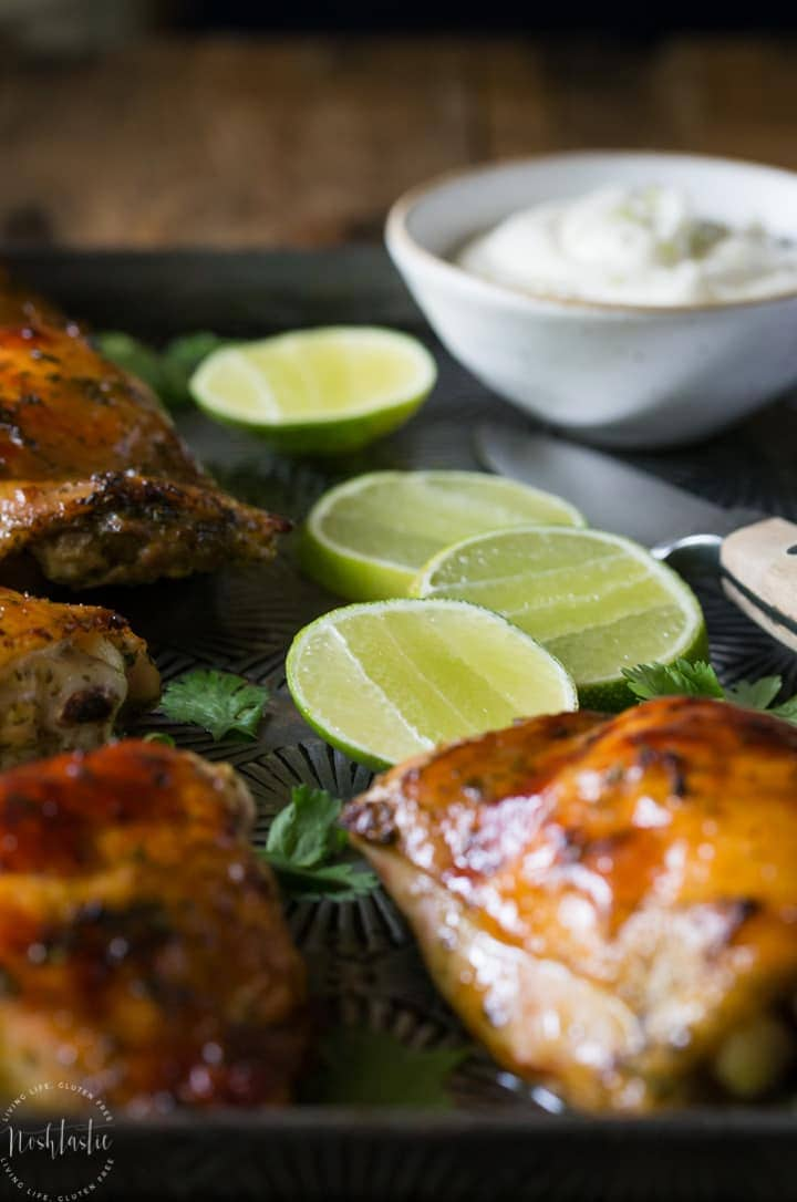 Crispy Baked Cilantro Lime Chicken with Garlic! Paleo and Whole 30 option. Made with a Cilantro, Honey, Allspice, Lime, Chili Flakes and Garlic marinade.