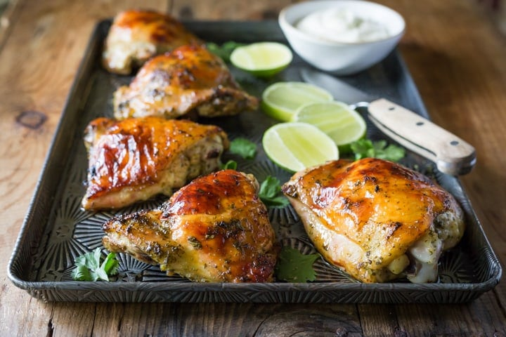 Easy baked Cilantro Lime Chicken! Made with a Cilantro, Honey, Allspice, Lime, Chili Flakes and Garlic marinade, this is a Paleo recipe with a Whole 30 option.