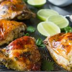 Easy baked Cilantro Lime Chicken with Garlic! Made with a Cilantro, Honey, Allspice, Lime, Chili Flakes and Garlic marinade, this is a Paleo recipe with a Whole 30 option.