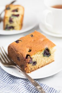 slice of gluten free blueberry cake on a white plate