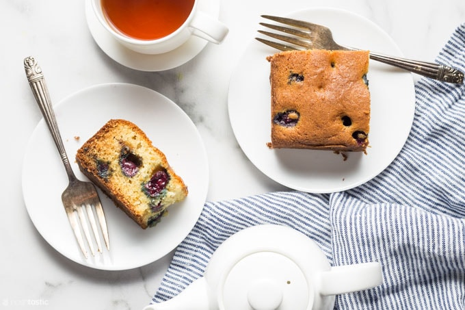 gluten free blueberry cake with cup of tea on a table
