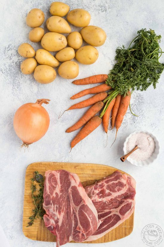 meat and vegetables on a table for making irish stew