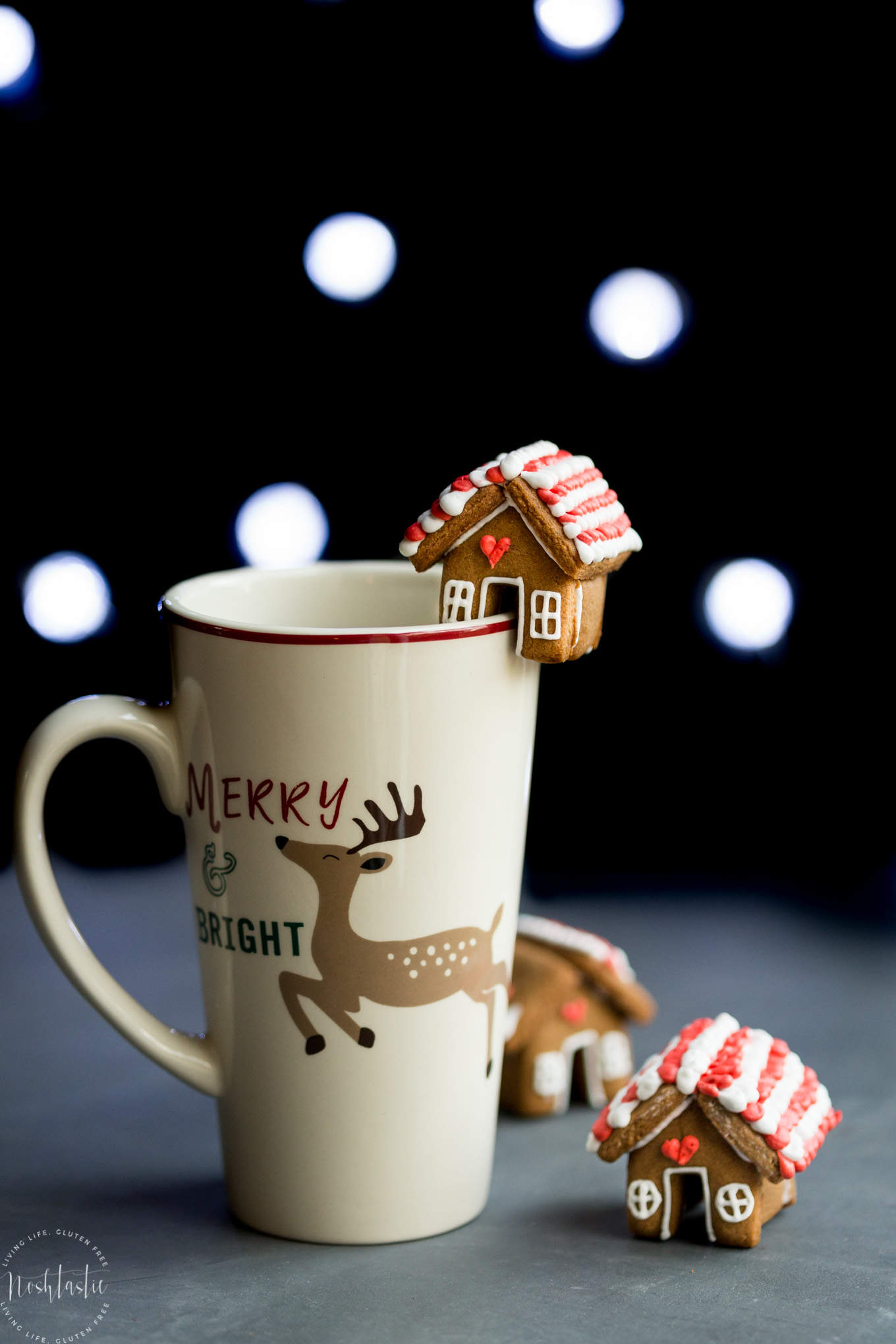 You can make these ADORABLE, cute, mini gingerbread house mug toppers, all the details are in the post! they are gluten free.