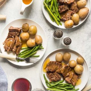 My Paleo Pot Roast is a firm family favorite and I think you'll love it too! I have instructions on how to cook it in the oven, slow cooker, and pressure cooker. #paleo #whole30 #paleorecipe