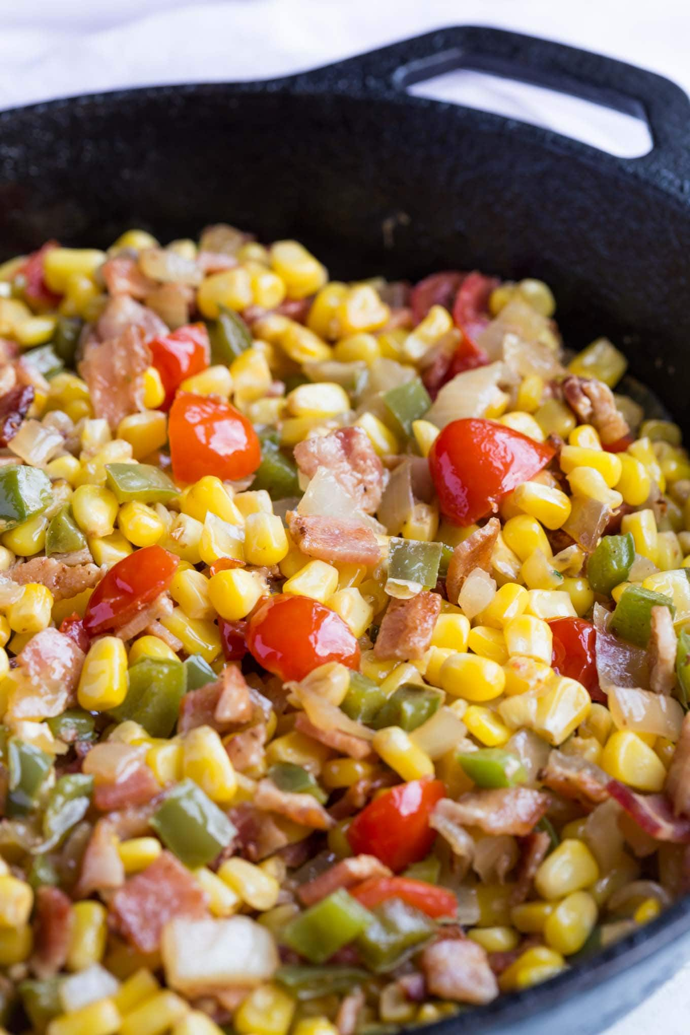 Corn Maque Choux is a classic cajun and southern side dish that's simple to make and packed with flavor, it's gluten free too!