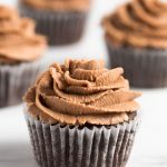 gluten free chocolate cupcake with chocolate frosting on a table
