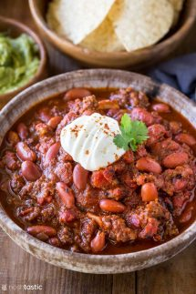 bowl of instant pot chili with sour cream on top
