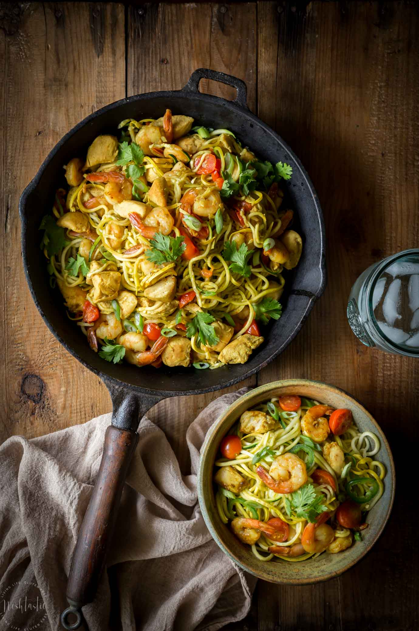 Paleo Singapore Noodles, made with zucchini noodles, shrimp, chicken and tasty mild curry flavored sauce with added turmeric! Gluten free, healthy and low carb with Whole30 options