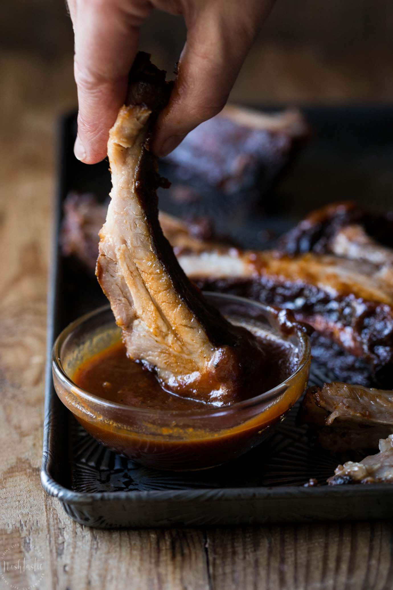 Slow Cooker Baby Back Ribs that are fall off the bone tender, delicious with a Memphis style rub and easy homemade BBQ sticky sauce! gluten free too!