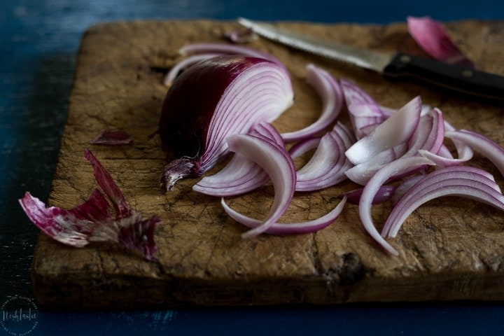 Chopped red onions on wood board