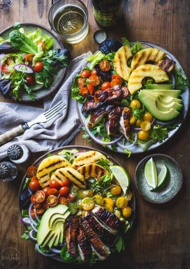 Cilantro Lime Chicken Salad, made with grilled pineapple, red onions, avocado, cherry tomatoes and served on a bed of lettuce. Healthy, Paleo and W30.