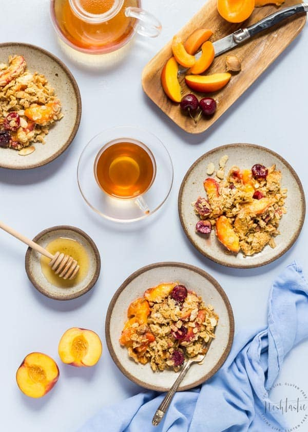 This is a really delicious Gluten Free Peach Crisp with Cherries and Apricots and topped with a tasty almond flour and oat crisp, it's perfect for breakfast or dessert!