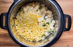 sweetcorn and potatoes in a pressure cooker