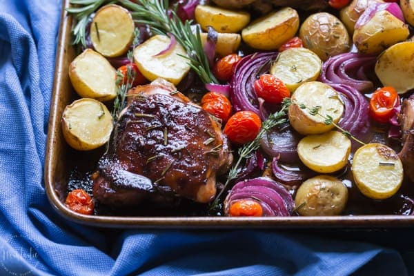 You need to try my delicious, easy, sheet pan Paleo Balsamic Chicken recipe with Roasted Potatoes, Red Onion, Tomatoes & fresh herbs! You can cook it on one pan in the oven in an hour or less!