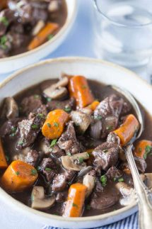 Easy and delicious Pressure Cooker Beef Bourguignon recipe made with beef, onions, garlic, mushrooms and red wine. Also known as Beef Burgundy. You can cook this in your electric pressure cooker or instant pot. It's gluten free and can be made paleo