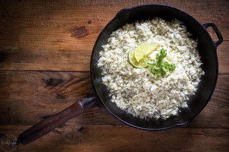 Cauliflower Cilantro Lime Rice is a fantastic substitute for real rice, it has way less calories and is perfect for people on a low carb or ketogenic diet. #keto #ketogenicdiet #lowcarb #cauliflowerrice #paleo #whole30 #glutenfree #cilantro #lime #lowcalorie #castironskillet