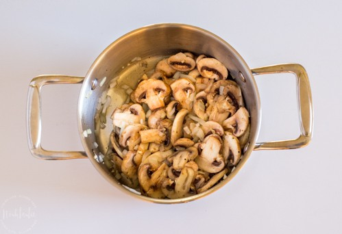 Cooked Mushrooms and onions in a pan