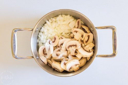 Mushrooms and onions in a pan