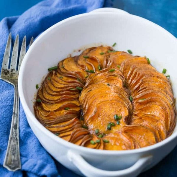 A gorgeous Paleo Scalloped Sweet Potato recipe that's both quick and easy to make, tastes great, and looks fantastic! It's perfect for your Thanksgiving table. #paleo #paleosweetpotatoes #paleothanksgiving #paleosides #paleodinner #paleorecipe #glutenfreethanksgiving #maplesyrup