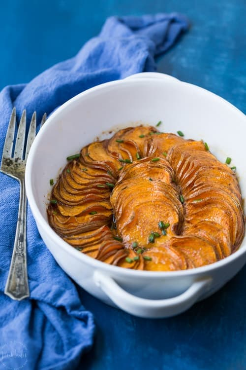 A gorgeous Paleo Scalloped Sweet Potato recipe that's both quick and easy to make, tastes great, and looks fantastic! It's perfect for your Thanksgiving table. #paleo #paleosweetpotatoes #paleothanksgiving #paleosides #paleodinner #paleorecipe #glutenfreethanksgiving