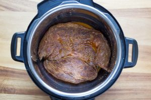 Browned pot roast in a pressure cooker