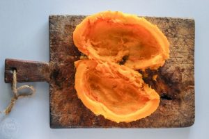 whole cooked pumpkin on a board