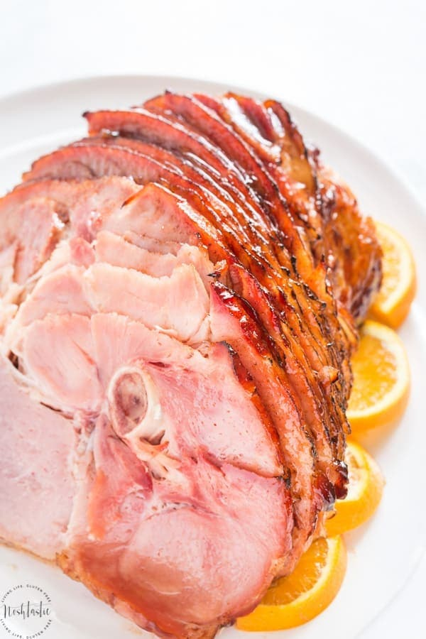 Brown Sugar Ham Glaze for Baked Ham, you can make the ham in a slow cooker or crockpot, or warm it in the oven then add the brown sugar glaze and broil. #glutenfree #noshtastic #glutenfreerecipe