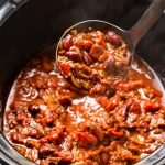 Slow Cooker Chili recipe - easy to make, this Crockpot chili is bursting with flavor and combines Ancho chili powder and fire roasted tomatoes to create an amazing flavor combination! #chilirecipe #crockpotrecipes #slowcookerrecipes #chiliconcarne #beefrecipes #beefchilirecipes #groundbeef #glutenfree #noshtastic