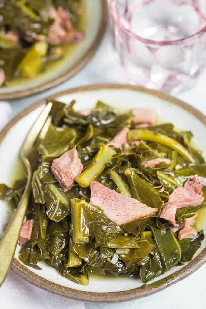 Pressure Cooker Collard Greens made in a fraction of the time in your pressure cooker or Instant Pot! Cooked with a smoked turkey leg and makes the most amazing 'pot likker' or pot liquor #instantpot #instapot #collardgreens #southernfood #soulfood #electricpressurecooker #glutenfreepressurecooker #glutenfreeinstantpot #glutenfree
