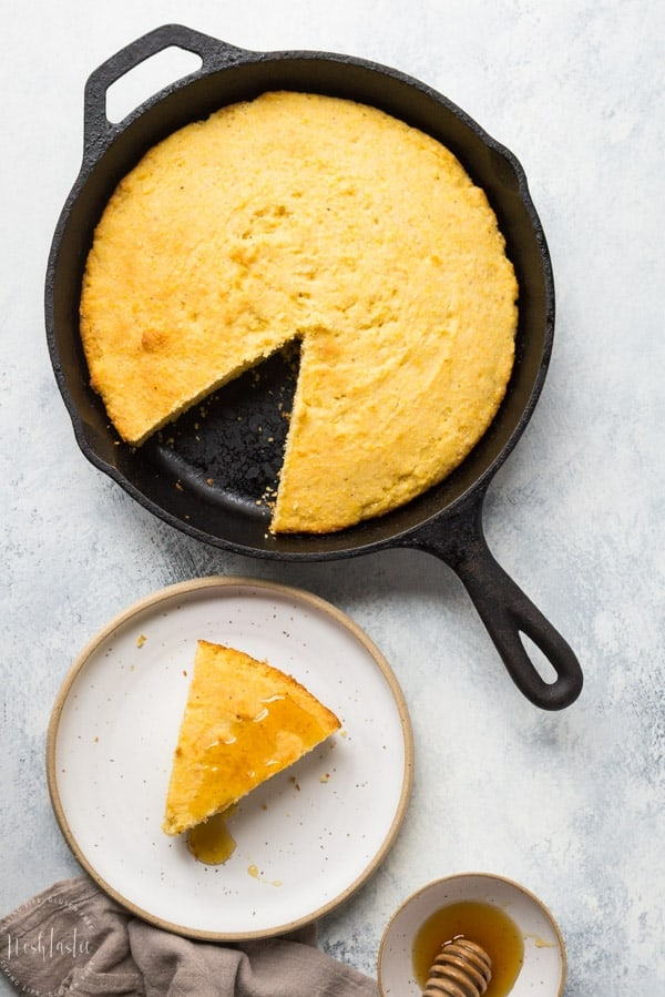 gluten free cornbread recipe from scratch, an easy skillet cornbread recipe you bake in a cast iron skillet #glutenfreecornbread #glutenfreebread #glutenfreebaking #glutenfreerecipe #noshtastic #glutenfree
