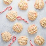 gluten free white chocolate chip cookies with peppermint and crushed candy canes! Perfect holiday cookies for Christmas and easy to make. #glutenfreecookies #christmascookies #glutenfree #sugarcookies