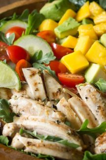 Chicken Avocado Salad with Honey Lime Dressing is such a fun summer salad! It's jam packed with healthy ingredients including arugula, spinach, and mango.  www.noshtastic.com   #chickensalad #chickenavocadosalad #glutenfreesalad #paleo #paleosalad #paleochicken #healthysalad #glutenfree #noshtastic #glutenfreerecipe