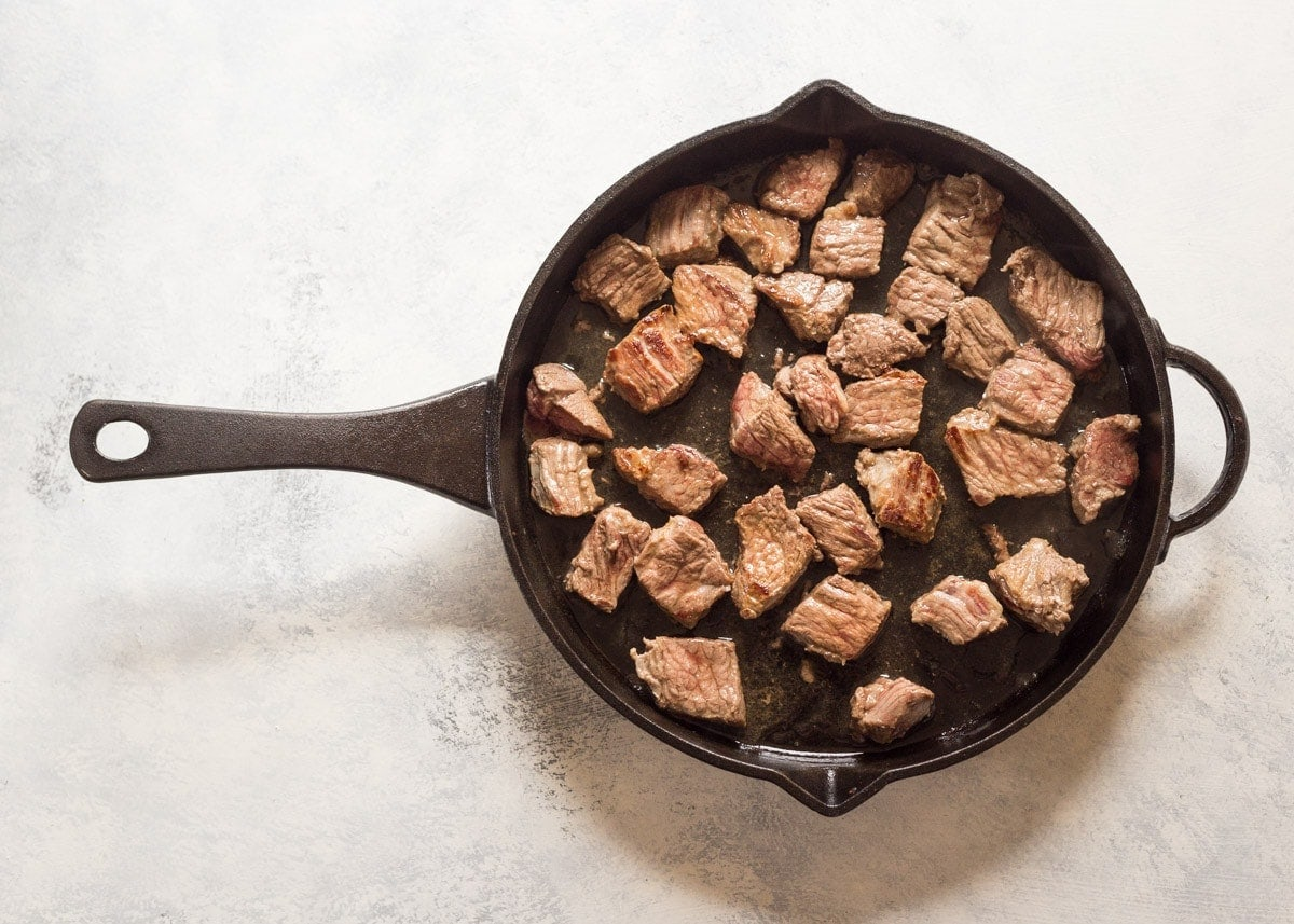 beef in a skillet for slow cooker beef stew