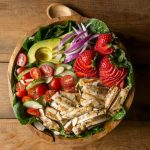 My Grilled Chicken Salad has all sorts of fabulous ingredients including, chicken marinated in garlic and fresh thyme, strawberries, almonds and is topped with an apple cider vinaigrette dressing. | www.noshtastic.com | #grilledchickensalad #chickensalad #grilledchicken #paleochickensalad #paleochicken #paleosalad #glutenfreesalad #glutenfree #noshtastic #glutenfreerecipe