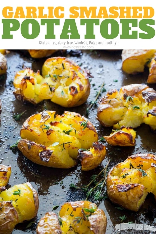 Paleo Smashed Potatoes baked with garlic, olive oil and herbs, fluffy in the middle and truly crispy on the top!! find out how to make them on noshtastic.com!! | paleo, gluten free, vegan, whole30, healthy recipe, side dish. baked potato, roasted potato. #roastpotatoes #garlicpotatoes #potatoes #noshtastic #whole30