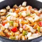 Potatoes O Brien Recipe in a skillet with bell peppers and onions